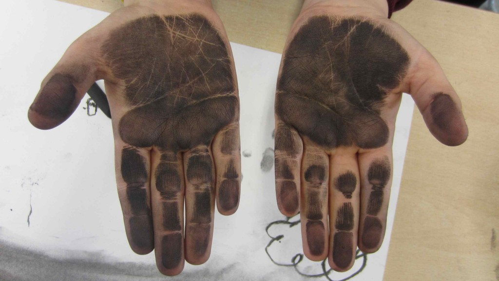 The lines on the palms of our hands had been made visible by the charcoal dust!