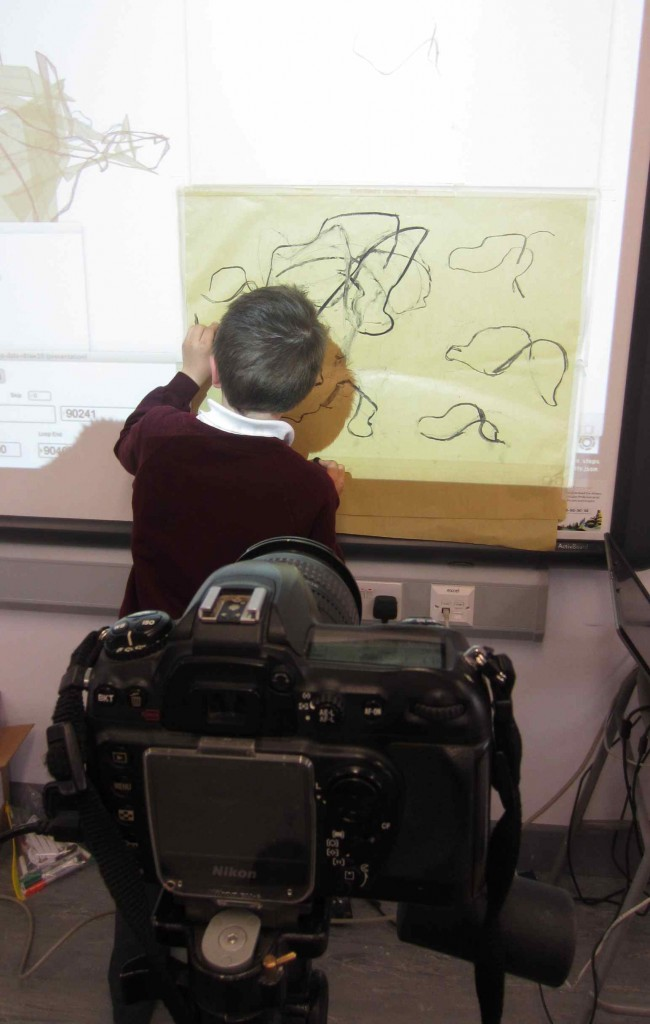 We used a stills camera to take photographs of the stages of the drawing.